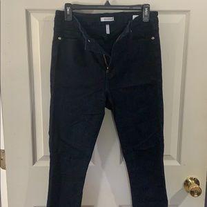 Good American dark blue jeans.